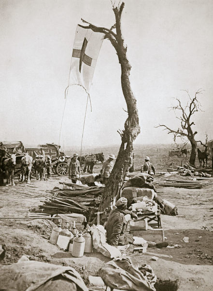 An advanced dressing station, Somme campaign, France, World War I, 1916. A Red Cross flag is affixed to a tree