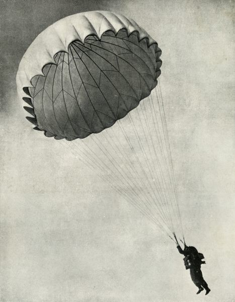 "Airman using a parachute during the Second World War, 1941. 'The ""free"" parachute type is standardised in the R.A.F., and with it parachutist jumps with the pack attached.' From ""The Royal Air Force in Pictures"""