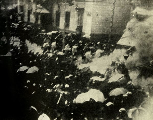 A bomb explodes on the day of the wedding of King Alfonso XIII and Victoria Eugenie of Spain, Madrid, 31 May 1906, (1910). 'The most remarkable Press picture ever obtained - The actual exploding of the bomb thrown at the King and Queen of Spain'