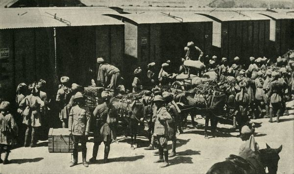 British and Indian soldiers at Bombay, India, First World War, 1914, (c1920). 'India's Army for the European War: Unloading Regimental Baggage before embarking at Alexandra Dock, Bombay', [Mumbai]. Over one million Indian troops in the British Indian Army