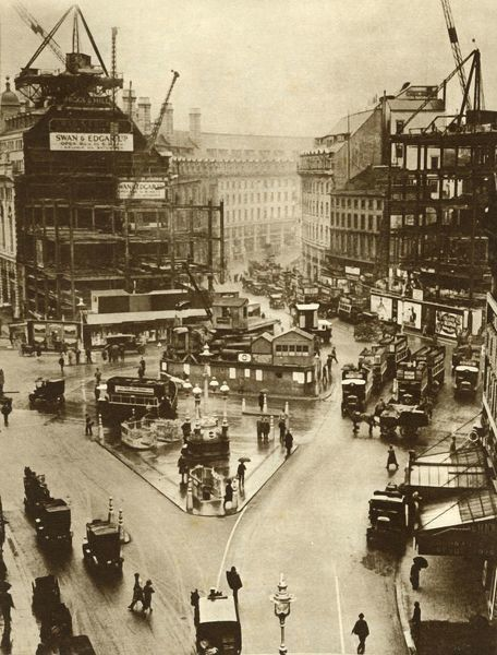 "Building work at Piccadilly Circus in London, 1926, (1935). 'World's Busiest Roundabout - to simplify congestion of traffic in the main London thoroughfares, the ""roundabout"" system was instituted. The picture shows the new system in operation at Piccadilly"