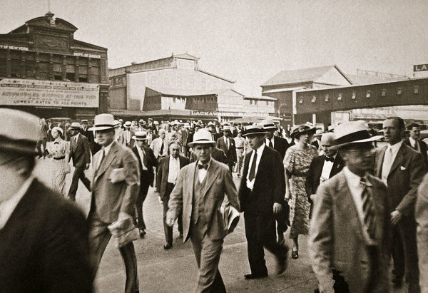 Commuters from New Jersey crossing West Street from the Hoboken ferry, New York, USA, early 1930s. On the way to their jobs in Manhattan
