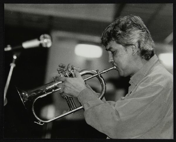 Dick Pearce playing the flugelhorn at The Fairway, Welwyn Garden City, Hertfordshire, 21 February 1999
