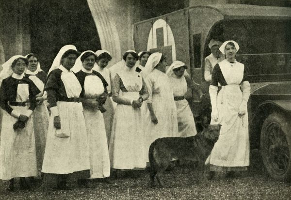 The Duchess of Westminster with nurses, Le Touquet, First World War, 1914, (c1920). 'With the Red Cross in France: the Duchess of Westminster (on the right, with her favourite dog) and some of the nurses at her military hospital at Le Touquet'