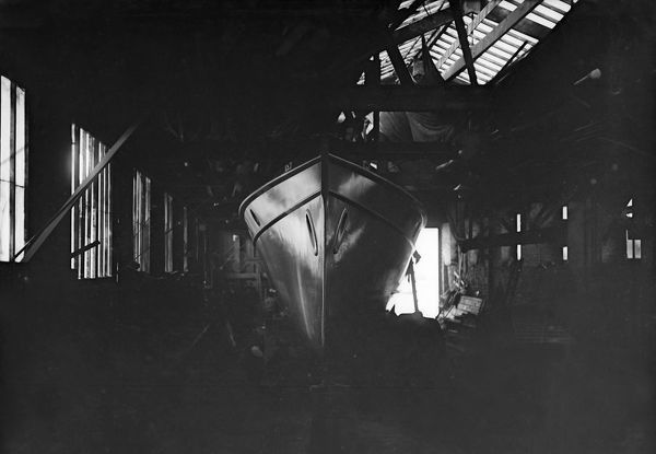 Egyptian motor launch in shed, 1911. Creator: Kirk & Sons of Cowes