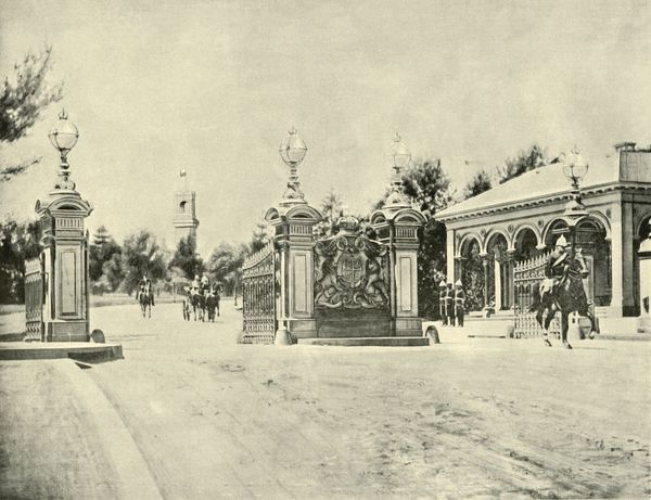 "'Entrance to Government House, Melbourne', 1901. Government House was opened in 1876, on land that originally been set aside in 1841. Designed by William Wardell in the Italianate style. From ""Federated Australia"". [The Werner Company"