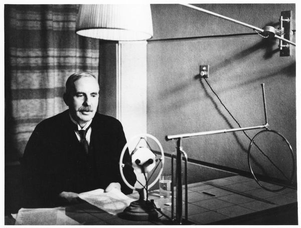 Ernest Rutherford broadcasting during a home visit to New Zealand in 1926. Artist: Anon