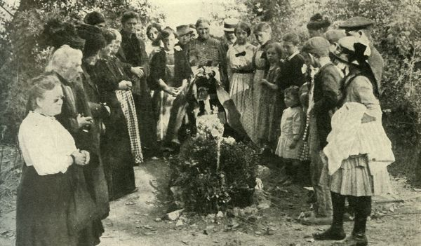 "French civilians at the grave of a soldier, 1914, (c1920). 'Honouring a Highland Hero: The Grave of one of the ""Seaforths"" killed in action at La Ferte'. Women and children gather around the grave of a soldier of the Seaforth Highlanders"