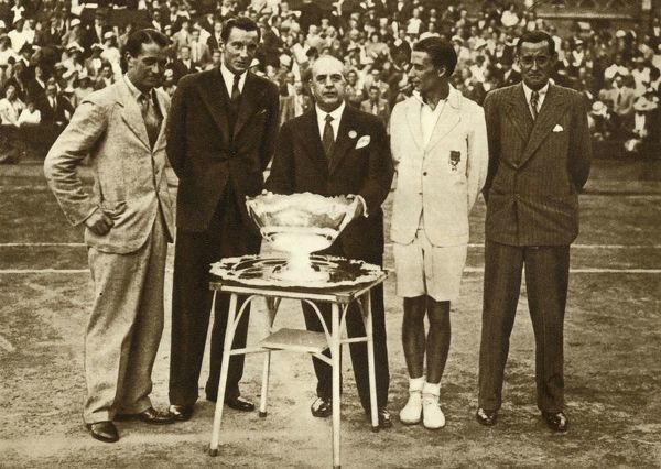 Great Britain wins the Davis Cup tennis championship, Paris, 30 July 1933, (1935). 'Great Britain won the Davis Cup for the first time in twenty-two years'. Left to right: Harry Lee, Fred Perry, Herbert Roper Barrett (non-playing captain), Bunny Austin and Pat Hughes