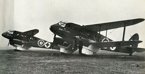 "'The De Havilland Ambulance', 1941. The de Havilland DH89 Dragon Rapide, British short-haul biplane airliner for 6-8 passengers, converted for use as an air ambulance during the Second World War. From ""The Royal Air Force in Pictures"""