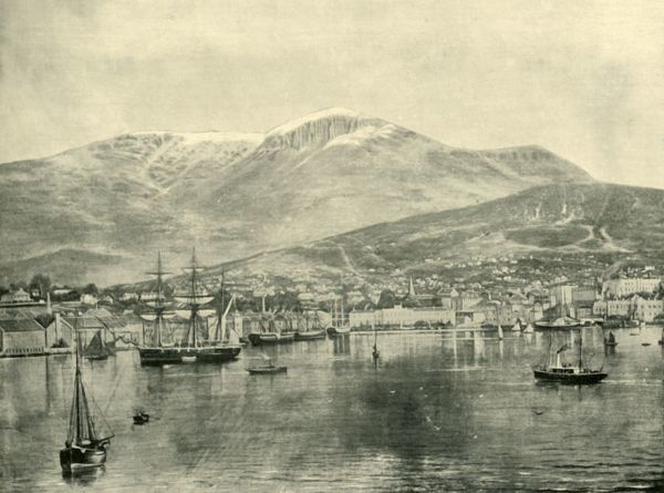 "'Hobart, from the Bay', 1901. The first European settlement of Hobart on the estuary of the Derwent River in Tasmania as a colonial outpost began with a military camp in 1803. From ""Federated Australia"". [The Werner Company, London, 1901]"