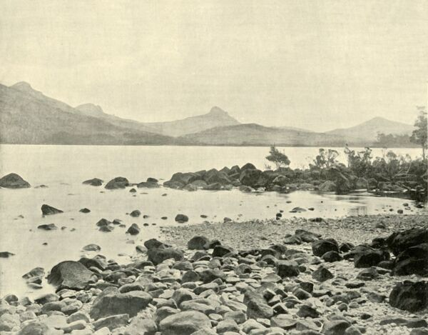 'At Lake St. Clair', 1901. A natural freshwater lake located in the Central Highlands of Tasmania. The first European explorer to see the lake was surveyor William Sharland in 1832, with George Frankland leading an expedition three years later
