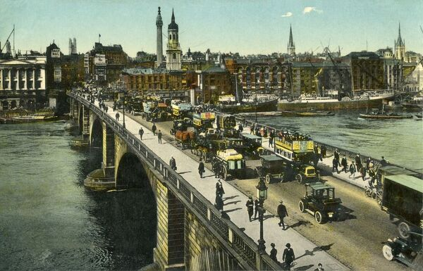 London Bridge, c1910. View of horse-drawn buses on London Bridge, looking towards the City from Southwark. On the left of the bridge is Fishmongers' Hall, with the Monument and church of St Magnus the Martyr in the centre. Postcard