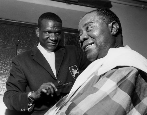 Louis Armstrong having haircut in Hammersmith, London, 1962. Creator: Brian Foskett