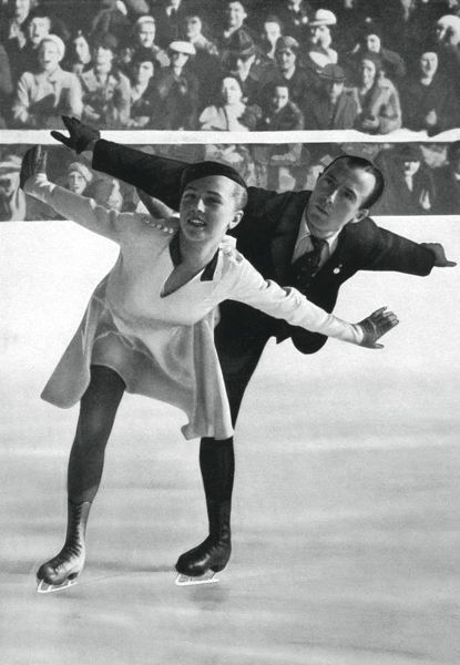 Pairs figure skating, Winter Olympic Games, Garmisch-Partenkirchen, Germany, 1936. Maxi Herber and Ernst Baier who won the gold medal in the event. A print from Olympia 1936, Die Olympischen Spiele 1936, Volume I, Cigaretten-Bilderdienst