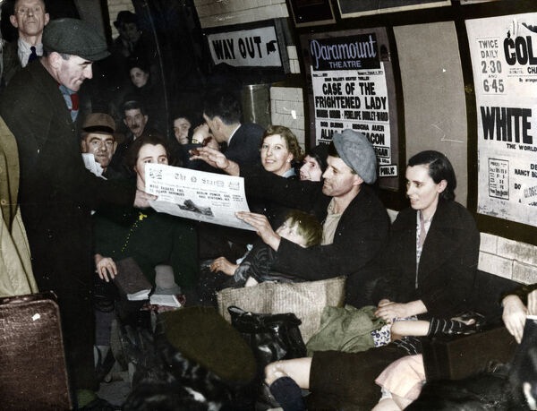 Paper seller down in the underground, London. c.1940. (Colorised black and white print)