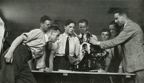 "RAF personnel receiving aero-engine instruction, 1941. Airmen at training school during the Second World War: 'Knowledge of the working and construction of the engine and the airframe is instilled in stages.' From ""The Royal Air Force in Pictures"""