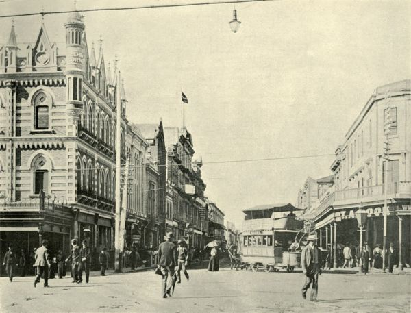 "'Rundle Street, Adelaide', 1901. Street was named after John Rundle, a director of the South Australia Company and member of the British House of Commons. From ""Federated Australia"". [The Werner Company, London, 1901]"