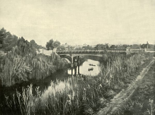 "'Torrens Lake, Adelaide', 1901. Torrens Lake, created in 1881 with construction of a weir in landscaped Elder Park.From ""Federated Australia"". [The Werner Company, London, 1901]"