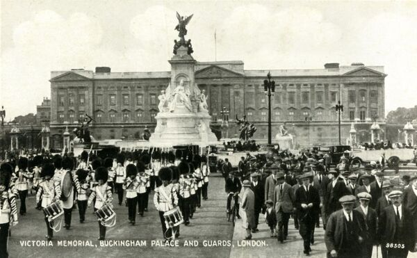 'Victoria Memorial, Buckingham Palace and Guards, London', 1930s. 'This magnificent memorial tothe late Queen Victoria stands in front of Buckingham Palace, which makes a fitting background to the sculpture. The Guards' Band is seen passing on its way to St