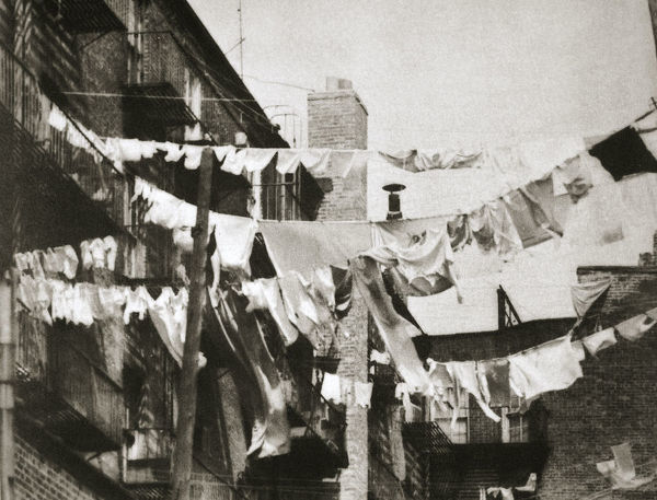 Wash day at some New York tenement buildings, USA, early 1930s. Artist: Unknown