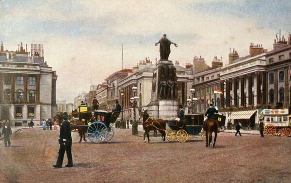 Waterloo Place, London, 1905. View of the intersection with Pall Mall looking north towards Piccadilly, with the Crimean War Memorial in the foreground. The monument, designed by John Bell, commemorates the Allied victory in the Crimean War of 1853-1856
