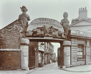 Ships' figureheads over the gate at Castle's Shipbreaking Yard, Westminster